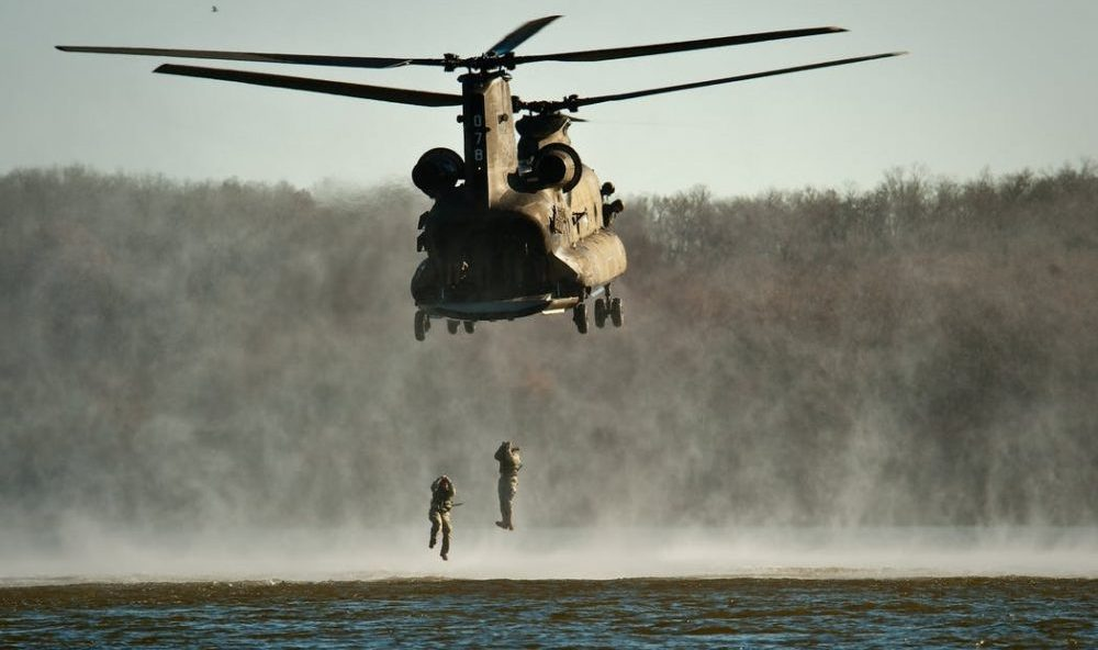 military helicopter over water